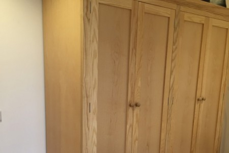 Traditional tall boy wardrobe manufactured in English Ash, polished in satin lacquer.