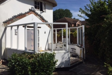 Showing the new conservatory being constructed